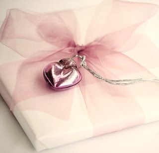 White gift wrap, pink tulle bow, pink charm