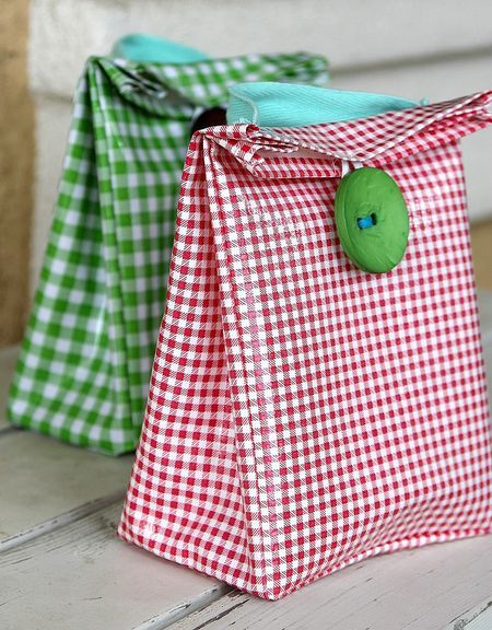DIY oilcloth lunch bags - fill with favors, and the bags are part of the gift to...