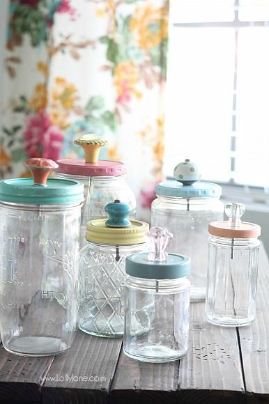 Recycle old glass jars by painting the lids + adding knobs to use as pretty stor...