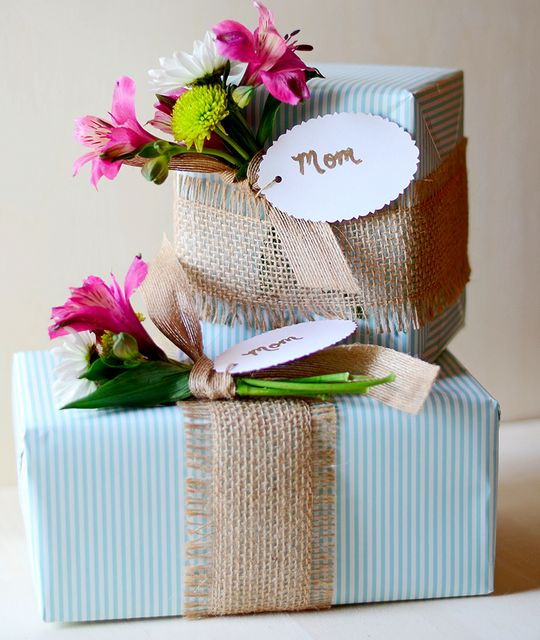wrapped with burlap ribbon & flowers