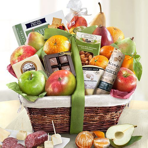 This grand-sized classic basket of orchard favorite fruits are accompanied by tw...