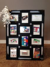 One of our basket raffle items- giftcards displayed in a multi- frame, can view ...